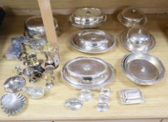 A quantity of plated items, including entree dishes and covers, two muffin dishes and covers and