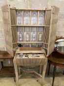 A Christopher Coane design British oak spirits cabinet, supplied with British spirits glassware