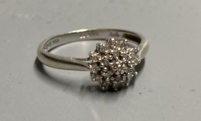 A modern 9ct white gold and diamond cluster ring, size M/N, gross 2 grams.CONDITION: Some wear to