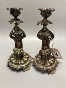Two patinated metal 'putti' candlesticks, height 20cm