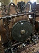 A Burmese hardwood dinner gong, width 104cm height 125cm