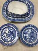 A collection of blue and white Willow pattern plates including meat platters, width 44cm and a