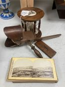 A stereoscope viewer with slides and a sand timer