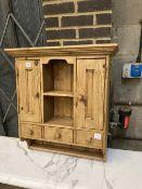 A small pine cabinet, width 69cm depth 23cm height 77cm