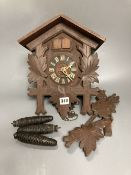 A Black Forest carved cedar cuckoo clock
