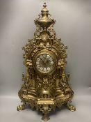 A large 20th century German brass mantel clock, 61cm