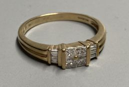 A modern 9ct gold and four stone princess cut diamond cluster ring, with six stone baguette cut