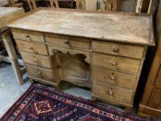 A Victorian pine kneehole desk, width 128cm depth 55cm height 82cm