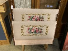 A pair of mid 20th century tapestry covered single bed headboards, larger width 98cm, height 124cm