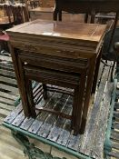 A nest of three Chinese hardwood occasional table, largest 45 x 31cm height 59cm