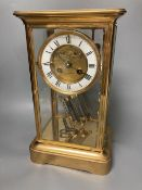 A French brass four glass mantel clock, retailed by J W Benson, with visible Brocot escapement and