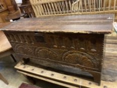 An elm and oak six plank coffer with lunette carved front, width 112cm depth 36cm height 58cm