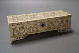 A 19th century Chinese ivory box, with finely carved and pierced detail, 18.5cm