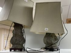A pair of Chinese bronze lamp bases, in Zhou dynasty style, 36cm high excluding light fittings