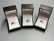 Three assorted modern 9ct or yellow metal and gem set dress rings, including white gold and marquise