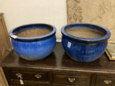 A pair of circular blue glazed garden planters, diameter 52cm, height 30cm