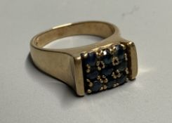 A mid to late 20th century 9ct and nine stone sapphire square cluster ring, size L, gross 5.6