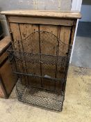 A 19th century pine wall cabinet, width 59cm depth 32cm height 84cm, together with a wirework rack