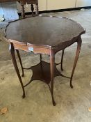 A late Victorian mahogany shaped circular topped two tier table, 67cm diameter, 72cm high