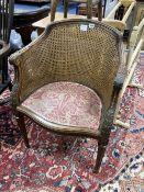 A caned tub chair