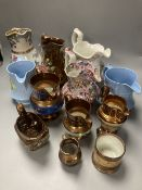 A collection of eleven lustre jugs and a mug, tallest 21cm