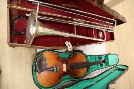 A violin, with 35.5cm back, with bow and some accessories, in case, together with Parrot trombone,