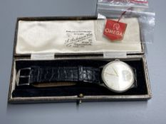 A gentleman's 1940's? stainless steel Omega manual wind wrist watch, with Arabic and dot numerals