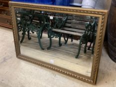 A modern gilt carved wood framed landscape wall mirror, width 116cm height 79cm