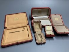 Five assorted Cartier gilt tooled leather jewellery boxes, largest 13.5cm.CONDITION: All boxes