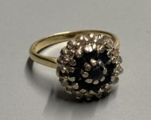 A modern 18ct gold, sapphire and diamond cluster dress ring, size K, gross 5.2 grams.CONDITION: