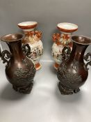 A pair of Japanese two handled bronzed vases and a pair of Japanese Kutani vases, tallest 37cm