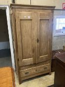 A 19th century French pine two door armoire, width 105cm depth 49cm height 195cm