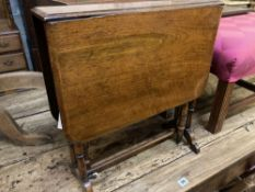 A small late Victorian walnut Sutherland table, width 50cm height 52cm