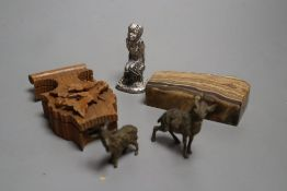 A carved boxwood watch stand, two cold painted bronze goats, an agate paperweight and a cast