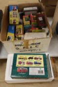 A collection of sixteen Matchbox die cast buses and other vehicles, many with original boxes