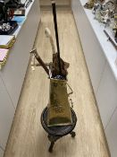 A carved tripod vase stand, an Arts & Crafts hammered brass vase, height 56cm, two umbrellas and two