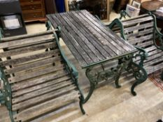 Four cast metal slatted wood garden armchairs and matching rectangular table, table 126 x 67cm,