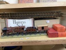A Hornby 'O' gauge Royal Scot 6100 clockwork locomotive and tender, two no. 31 coaches and a Flat