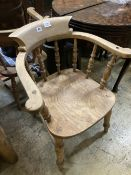 Two Victorian elm and beech smoker's bow elbow chairs together with six Windsor kitchen chairs