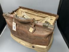 A Victorian leather doctor's Gladstone bag including doctor's equipment, height 29cm excluding