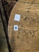 A George III oak tripod table, diameter 70cm height 67cm