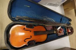 A French 3/4 size violin, Stradivarius label, with bow and accessories, in a case