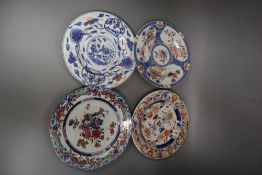 Four 18th century Chinese Imari dishes, 22.5cm, painted underglaze in typical palette