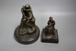A cast metal sculpture Kiss after Rodin, height 14cm and another of Arabs