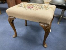 A Queen Anne revival walnut dressing stool, width 57cm depth 43cm height 46cmCONDITION: Woodworm