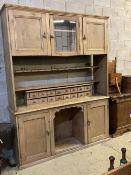 A large Victorian pine dresser, width 182cm depth 48cm height 240cmCONDITION: - 21 x 6.5cm dinner
