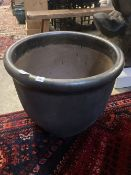 A large glazed gun metal garden planter, diameter 60cm