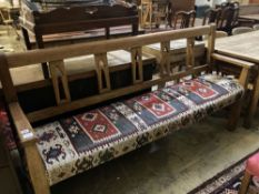 A 19th century Continental oak bench settle, with kelim upholstered seat, width 200cm depth 48cm