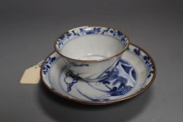 A Chinese Kangxi blue and white 'leaping carp' tea bowl and saucer, 13cm diameter