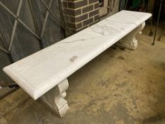 An early 20th century Italian carved white marble bench, with later marble top, width 182cm depth